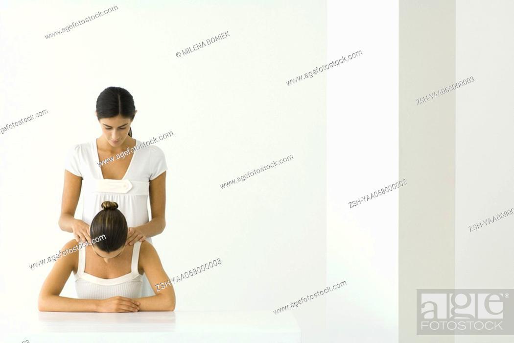 Stock Photo: Woman receiving shoulder massage.