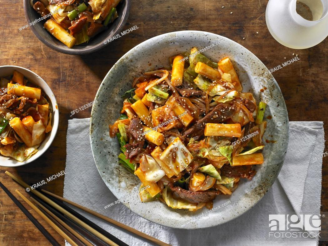 Stock Photo: Korean Rice Cakes (Tteok) with Red Chile Sauce.