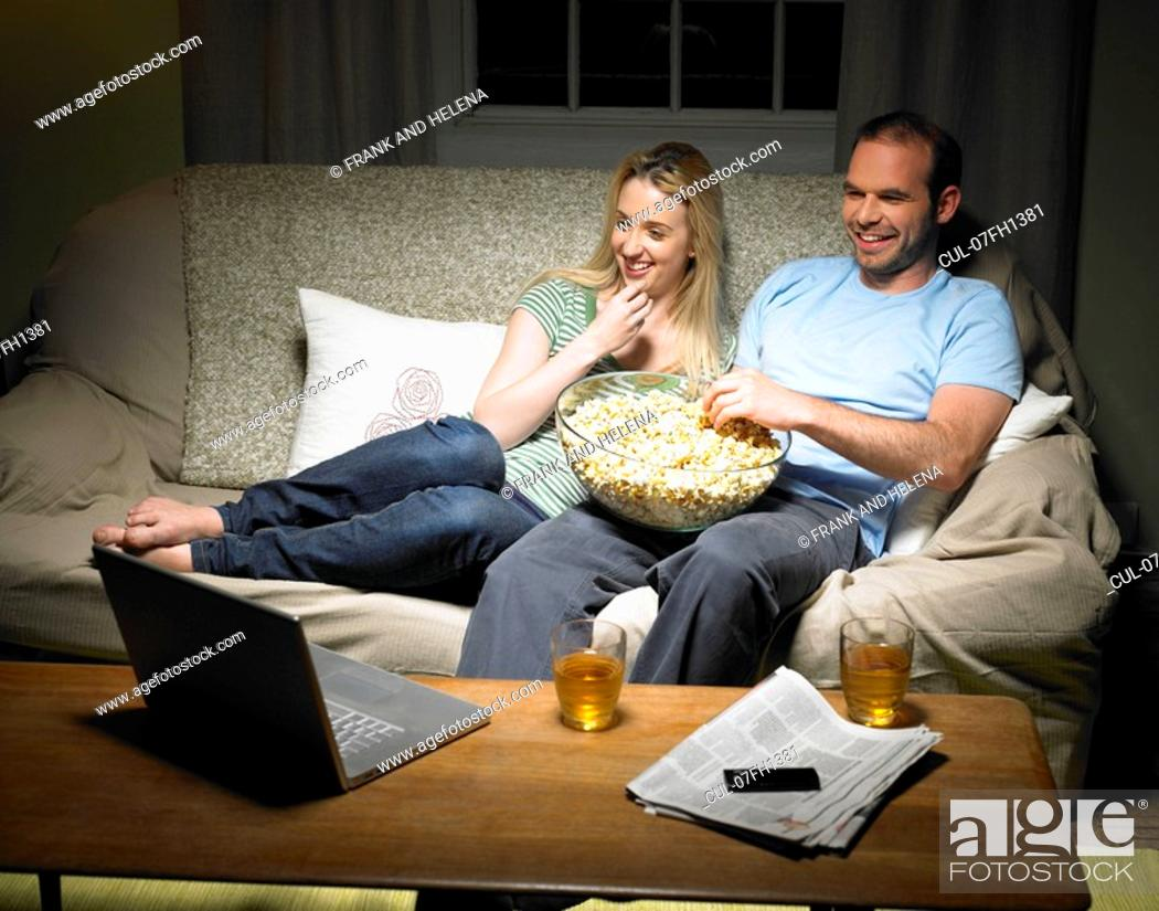 Stock Photo: Young couple watching a movie.