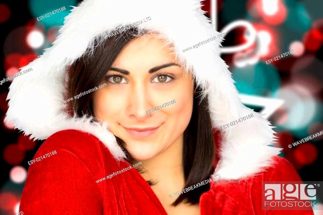 Stock Photo: Composite image of pretty girl smiling in santa outfit.