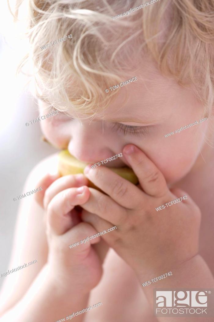Stock Photo: Germany, Bavaria, Boy eating apple, close up.