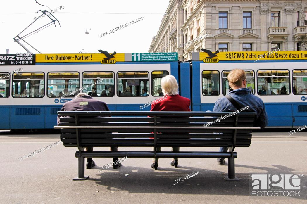 Stock Photo: People sitting on a bench, in Bahnhofstrasse, a popular street in Zurich, Switzerland.