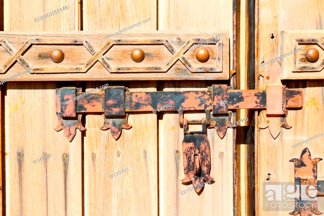 Stock Photo: in oman antique door entrance and decorative handle for background.