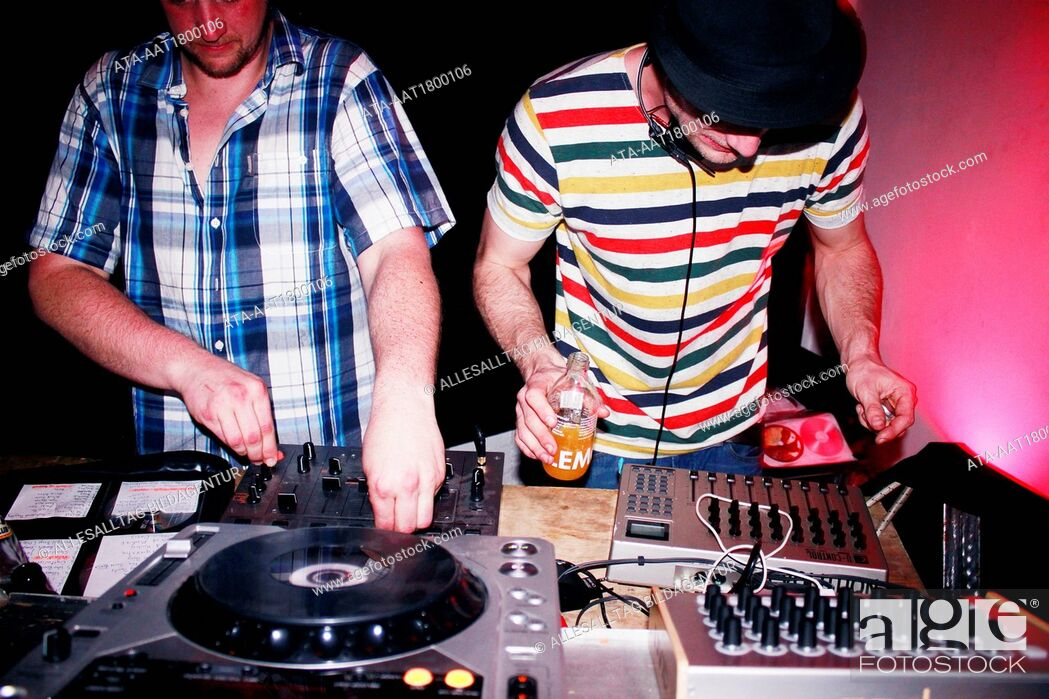 Stock Photo: Two DJ??s at the record turntables.