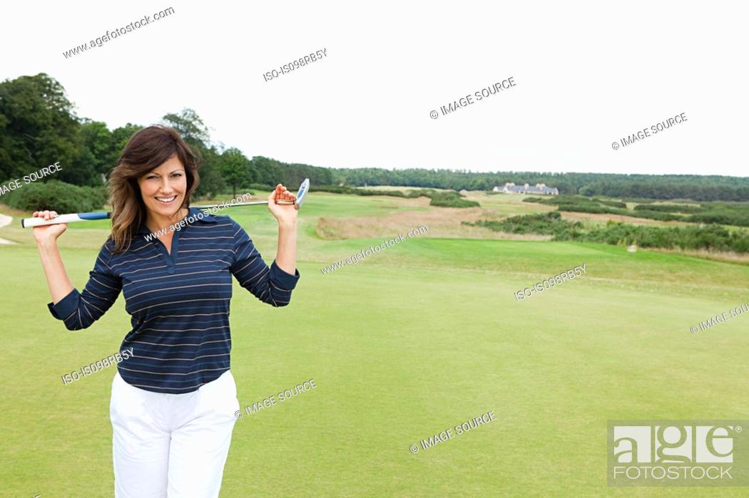 Stock Photo: Woman on golf course.