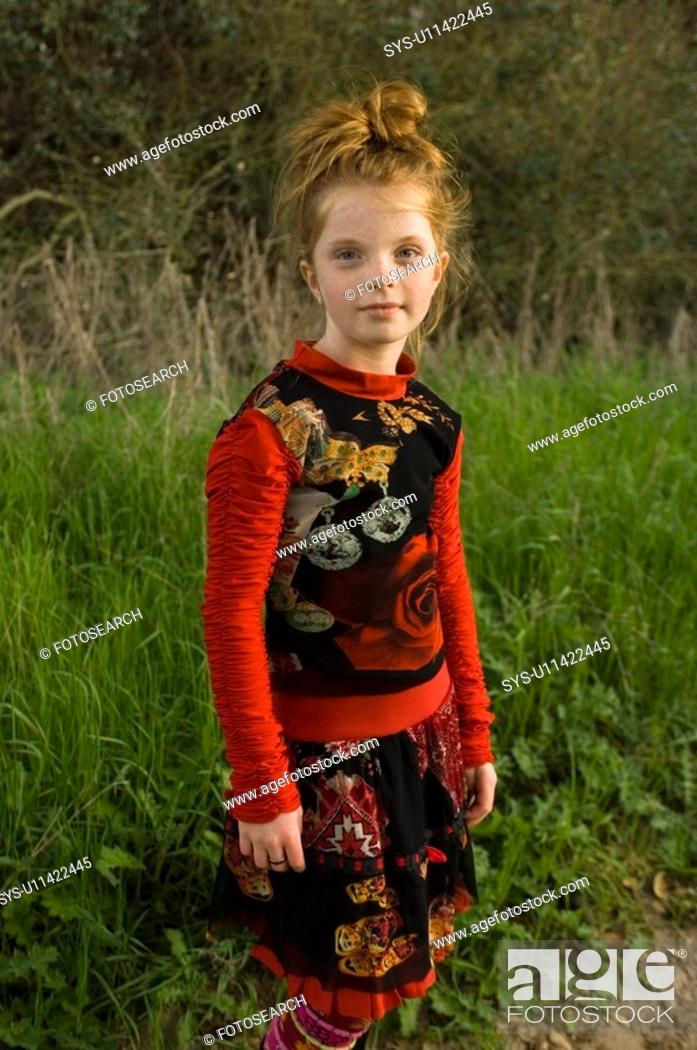 Stock Photo: Portrait of young girl outside.