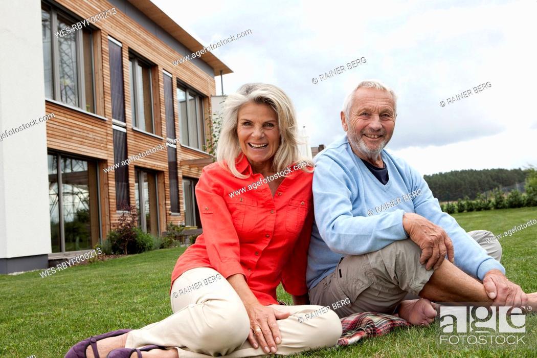 Stock Photo: Germany, Bavaria, Nuremberg, Senior couple smiling, portrait.