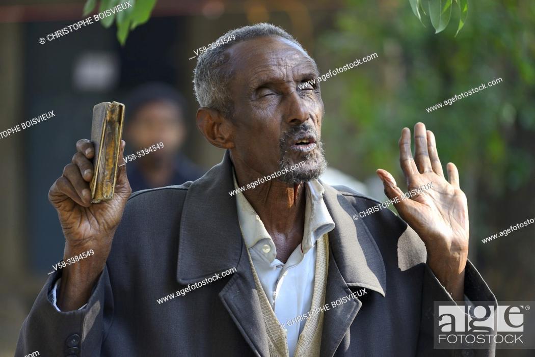 Stock Photo: Ethiopia, Gonder, Bahata church, Morning mass, Christian devotee in prayer.