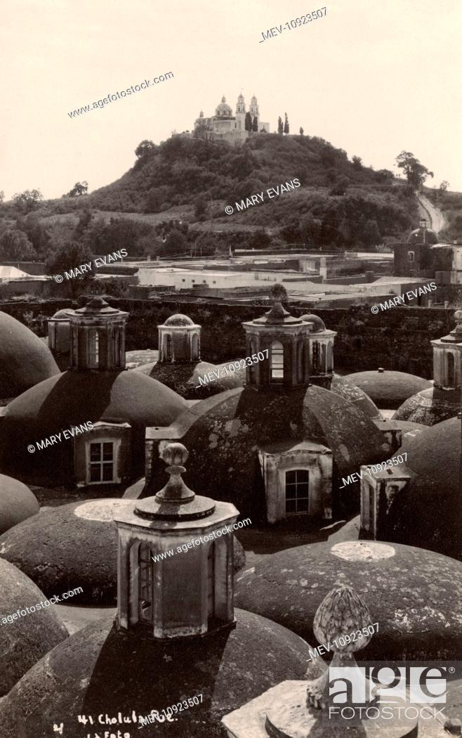 Stock Photo: Picture of Cholula with the Great Pyramid in the background that looks like a natural hill. Only a very small part is uncovered and restored.