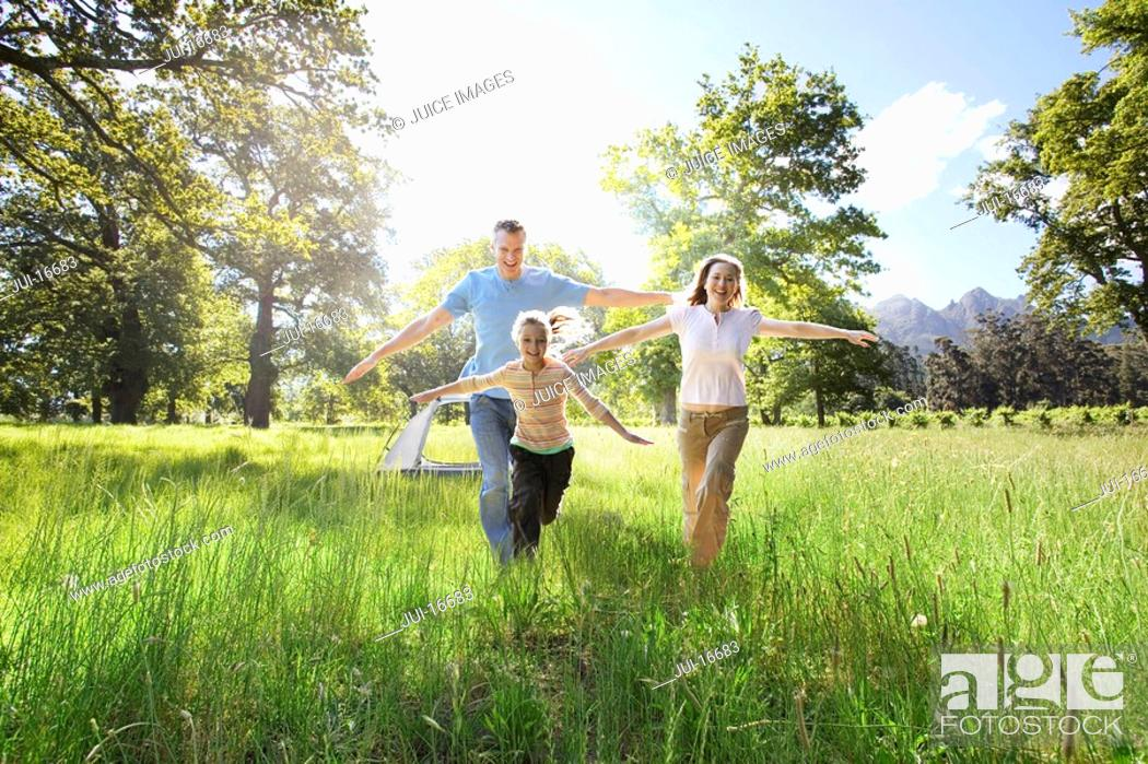 Stock Photo: Family running in field.