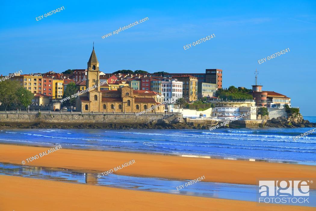 Stock Photo: Gijon beach San Lorenzo and San Pedro church in Asturias Spain.