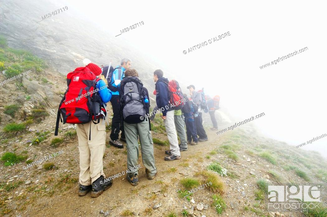Stock Photo: A group of young hikers get instructions by their tutor during a foggy day  lepontine alps  Verbano Cusio Ossola province  piemonte  italy  europe.