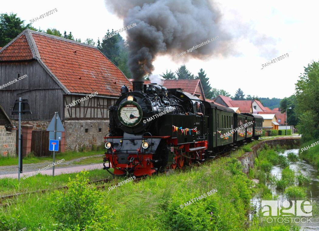 Stock Photo: A special train from the Harz Narrow Gage Railway (HSB) travels from Strassberg to Stiege, Germany, 03 June 2014. The work to rebuild the line was completed.