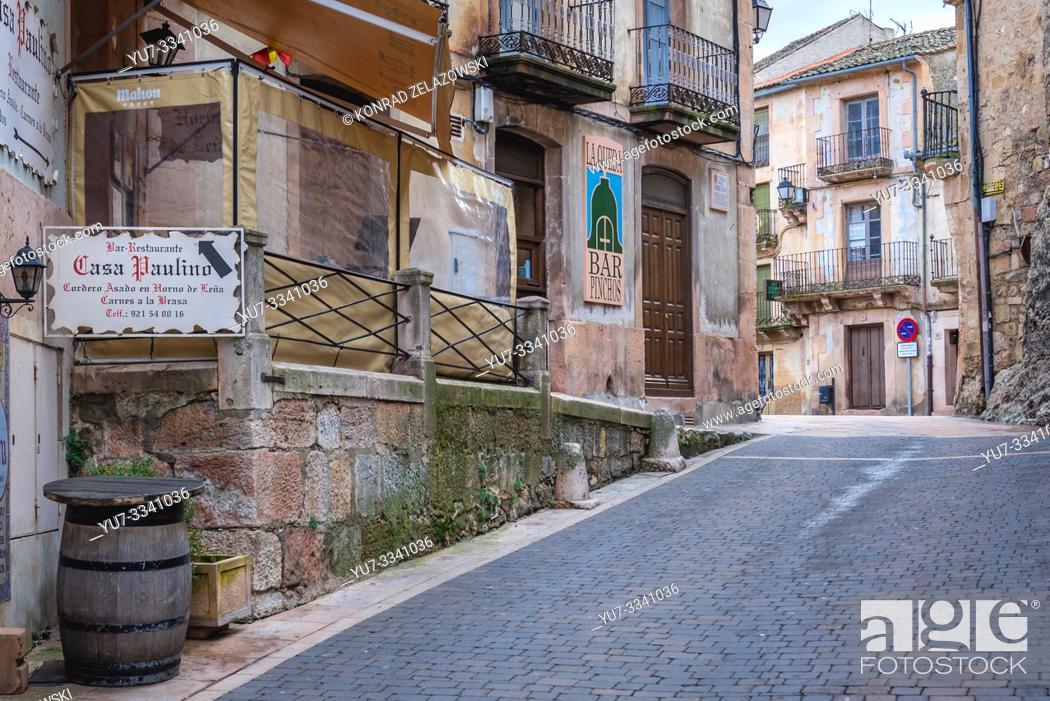 Stock Photo: Calle la Barbacana street with Casa Paulino restaurant in Sepulveda town in Province of Segovia, Castile and Leon autonomous community in Spain.