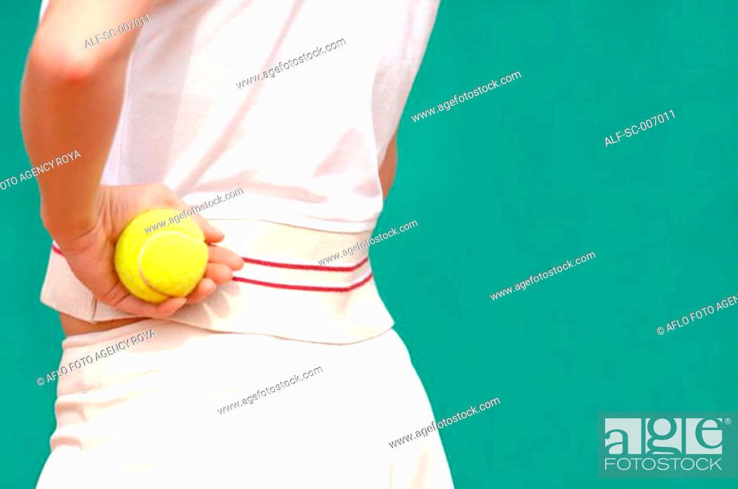 Stock Photo: Close-Up of Female Tennis Player Holding Ball.