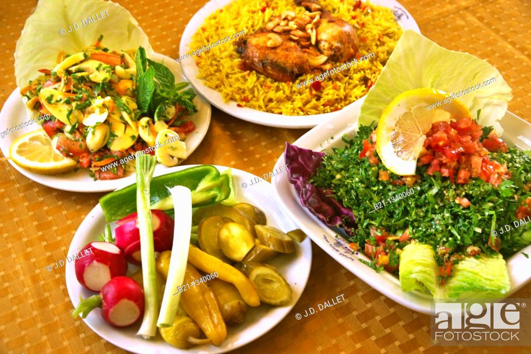 Stock Photo: Food: mushroom salad, pickles, chicken with rice and taboule. Damascus, Syria.