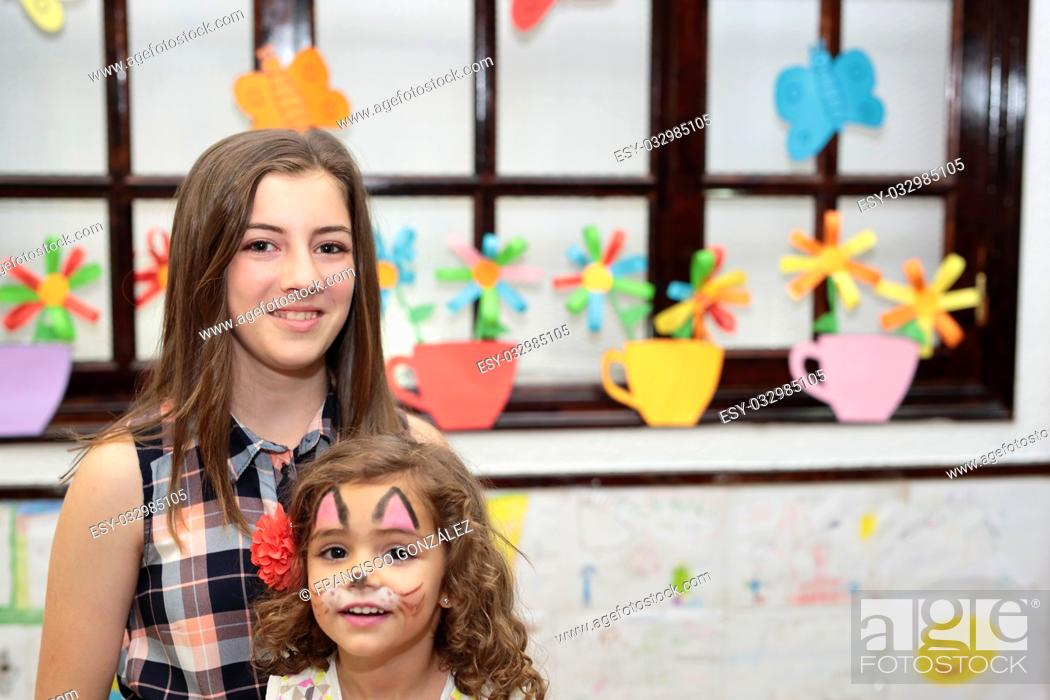 Stock Photo: girls at a family party colorfully.