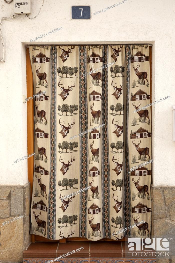 Stock Photo: Door with hunting cloth curtain, CAMPO REAL, MADRID province, SPAIN, EUROPE.