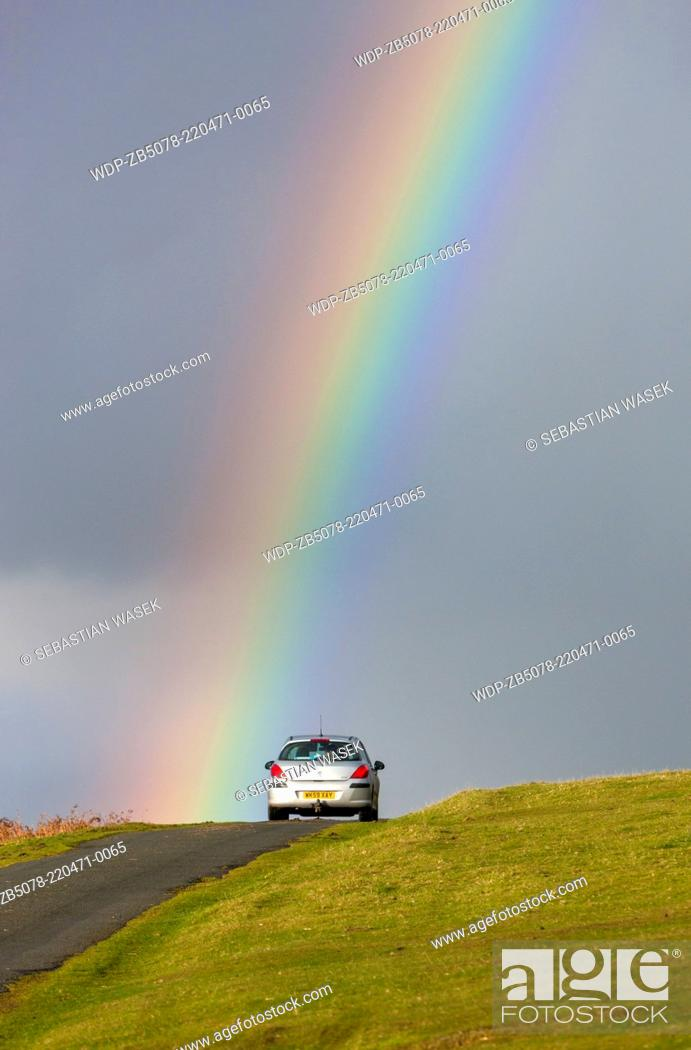 Stock Photo: Rainbow over road near Cox Tor in the Dartmoor National Park, Devon, England, UK, Europe.