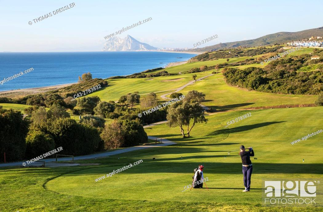 Stock Photo: Golfer at the La Alcaidesa Golf Resort at the Mediterranean Sea with the Rock of Gibraltar (British) in the background. Cadiz province, Andalusia, Spain.