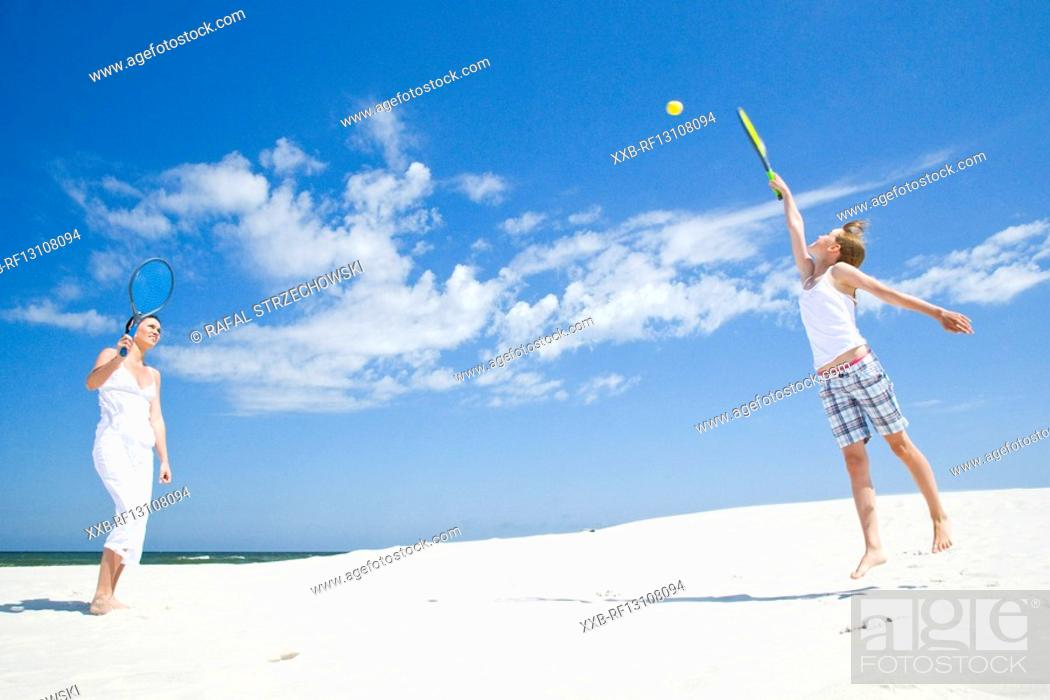 Stock Photo: mother and daughter playing badminton.