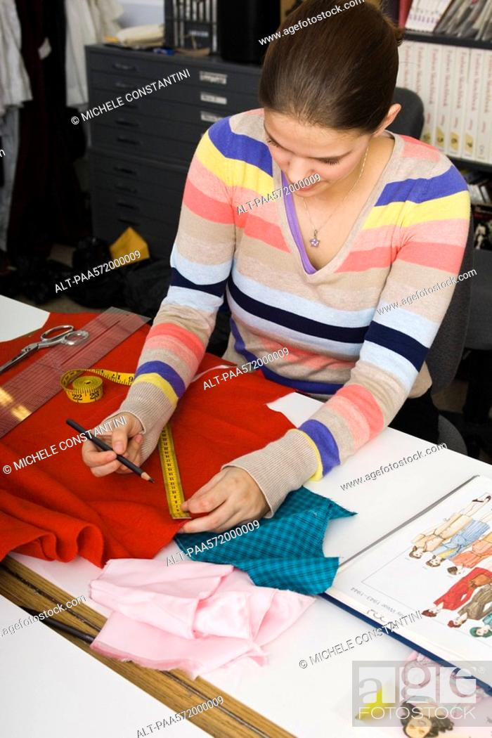 Stock Photo: Preparing fabric for sewing project.