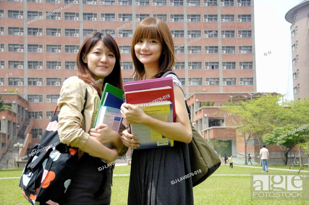 Stock Photo: Female university students standing together and smiling.