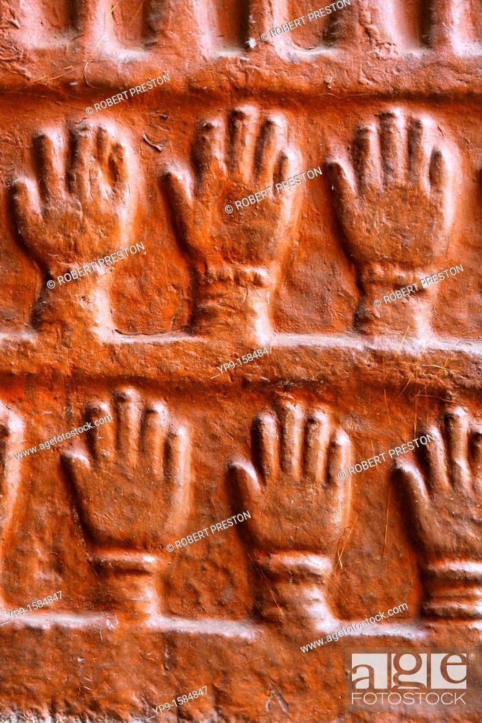Stock Photo: Sati handprints at Meherangarh Fort, Jodhpur, Rajasthan, India.