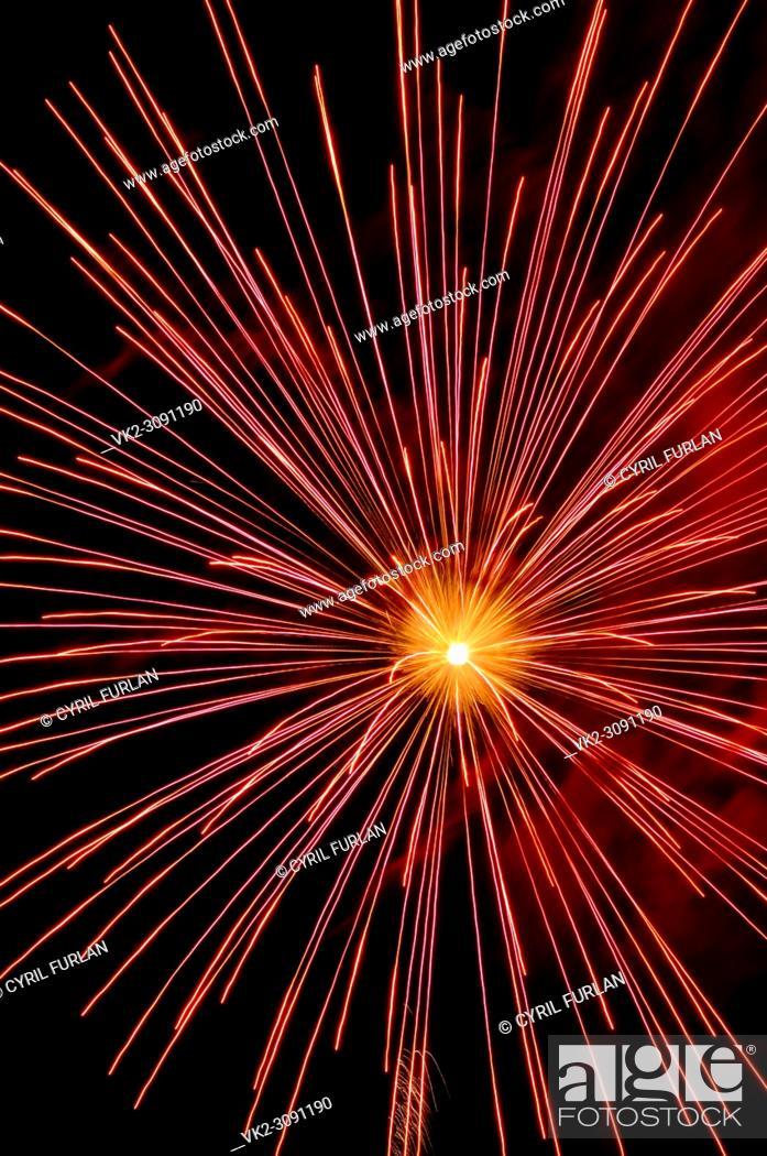 Stock Photo: Exploding red sky rocket July 4 celebration.