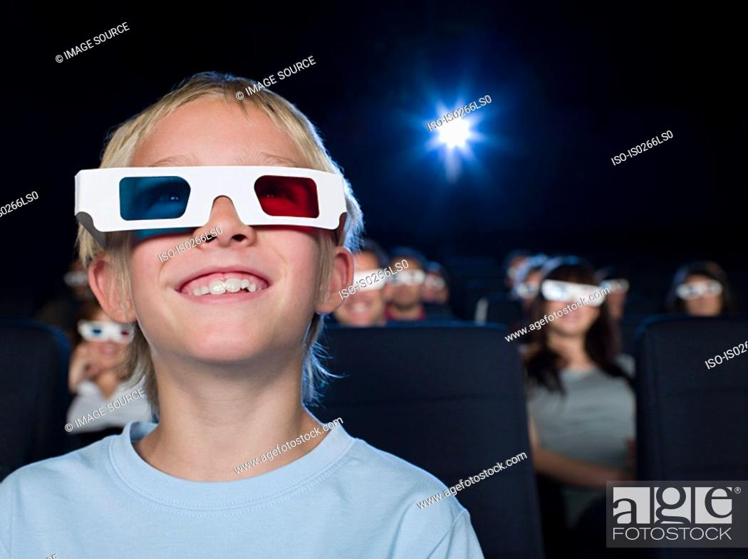 Stock Photo: A boy watching a 3d movie.
