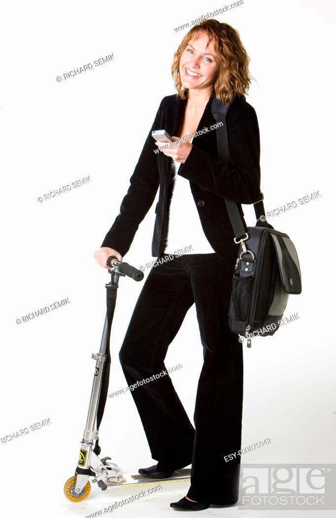 Stock Photo: businesswoman with a scooter.