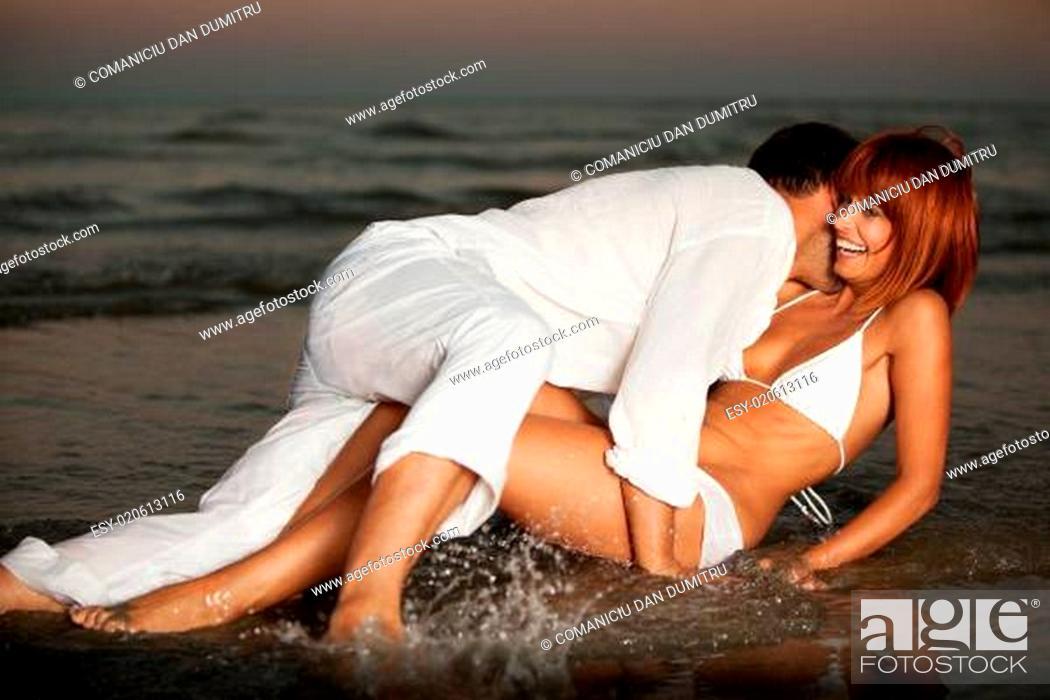 Stock Photo: happy, romantic couple, by the sea shore.