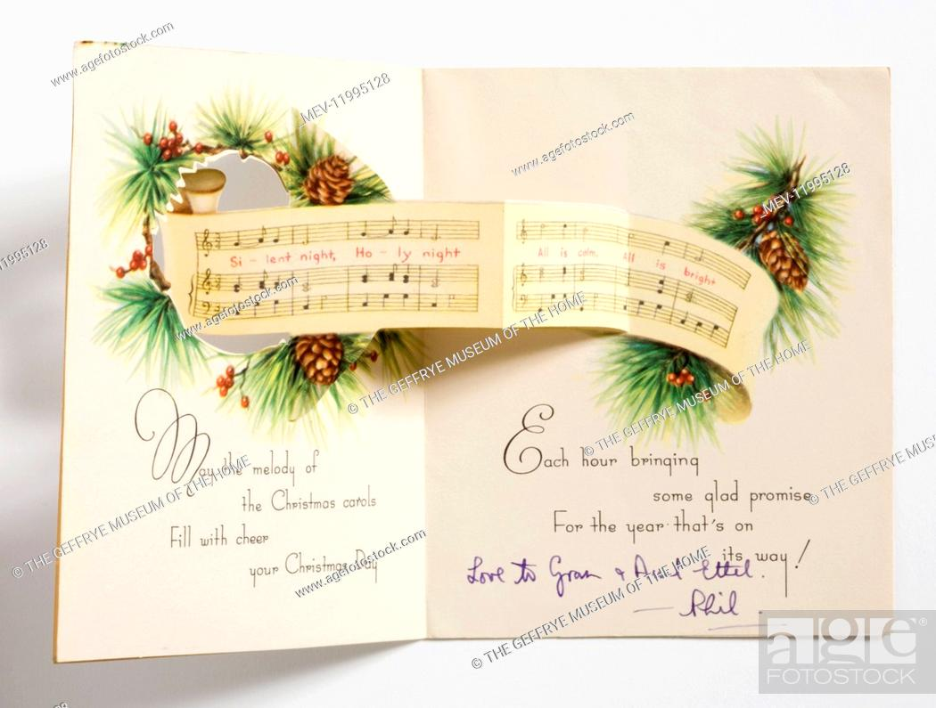 Stock Photo: Christmas card printed with a design of a group of carol singers below a fir branch motif with pine cones and two blue tits.