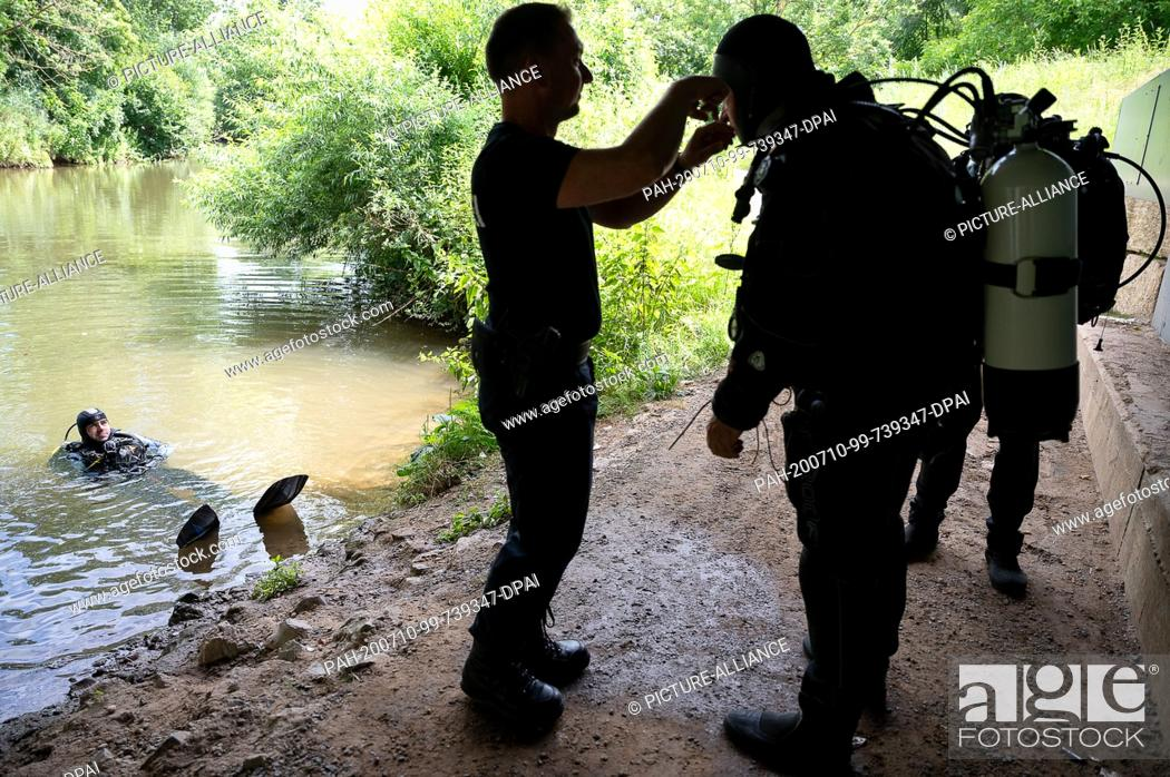 Stock Photo: 30 June 2020, Baden-Wuerttemberg, Schorndorf: Thomas Weller, duty group leader and training diver at the Stuttgart Water Police.