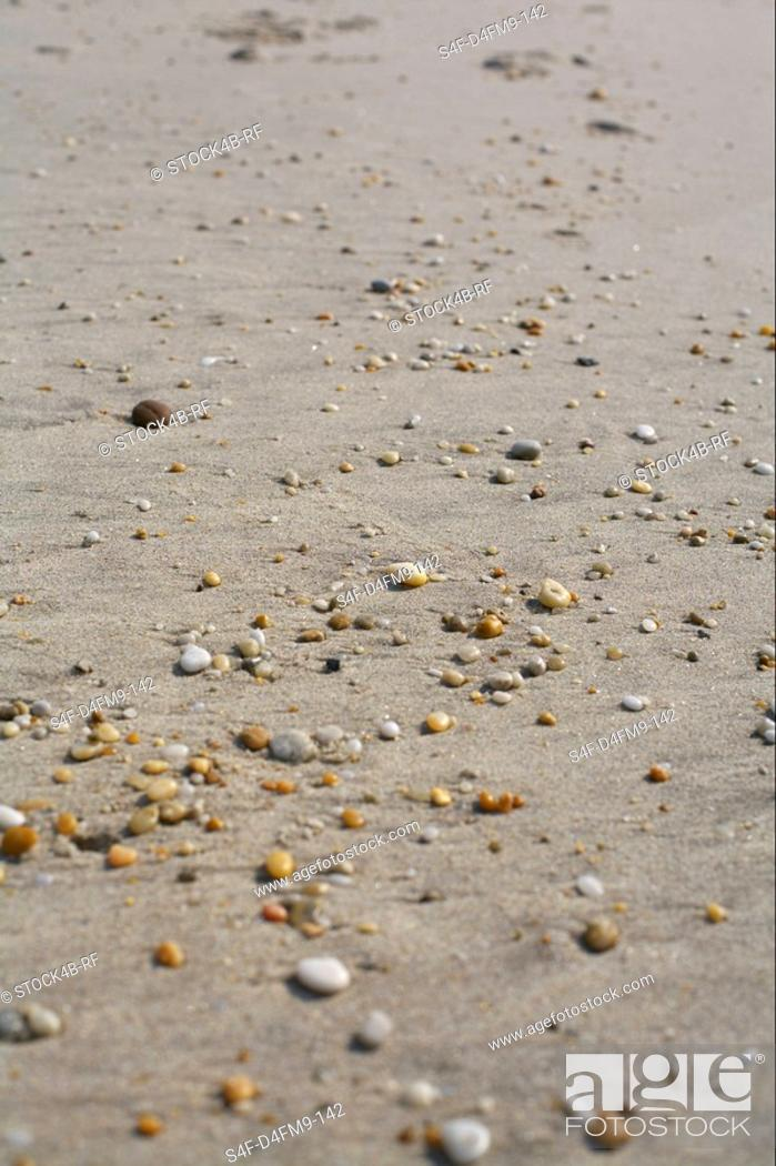 Stock Photo: Little stones at the beach, selective focus.