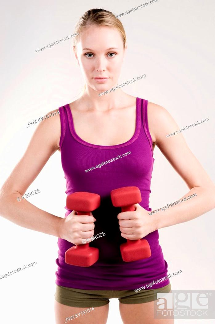 Stock Photo: Woman exercising with dumbbells.