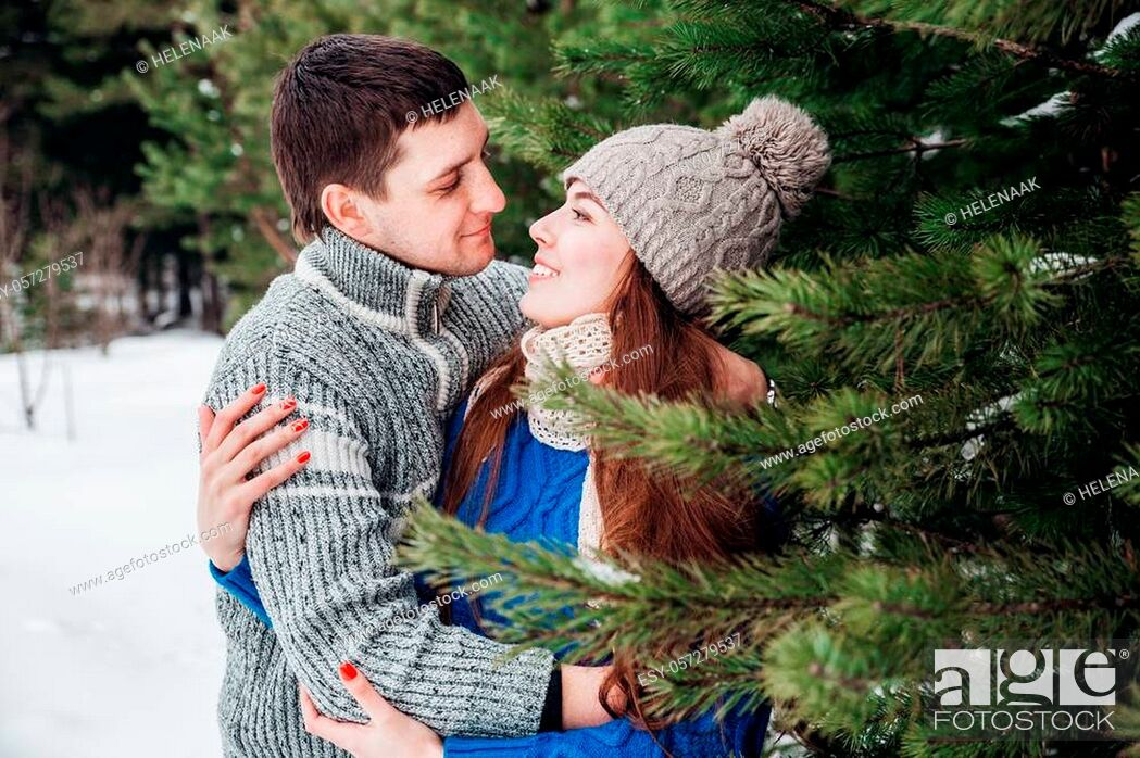 Stock Photo: outdoor portrait of young sensual couple in cold winter wather. love and kiss.