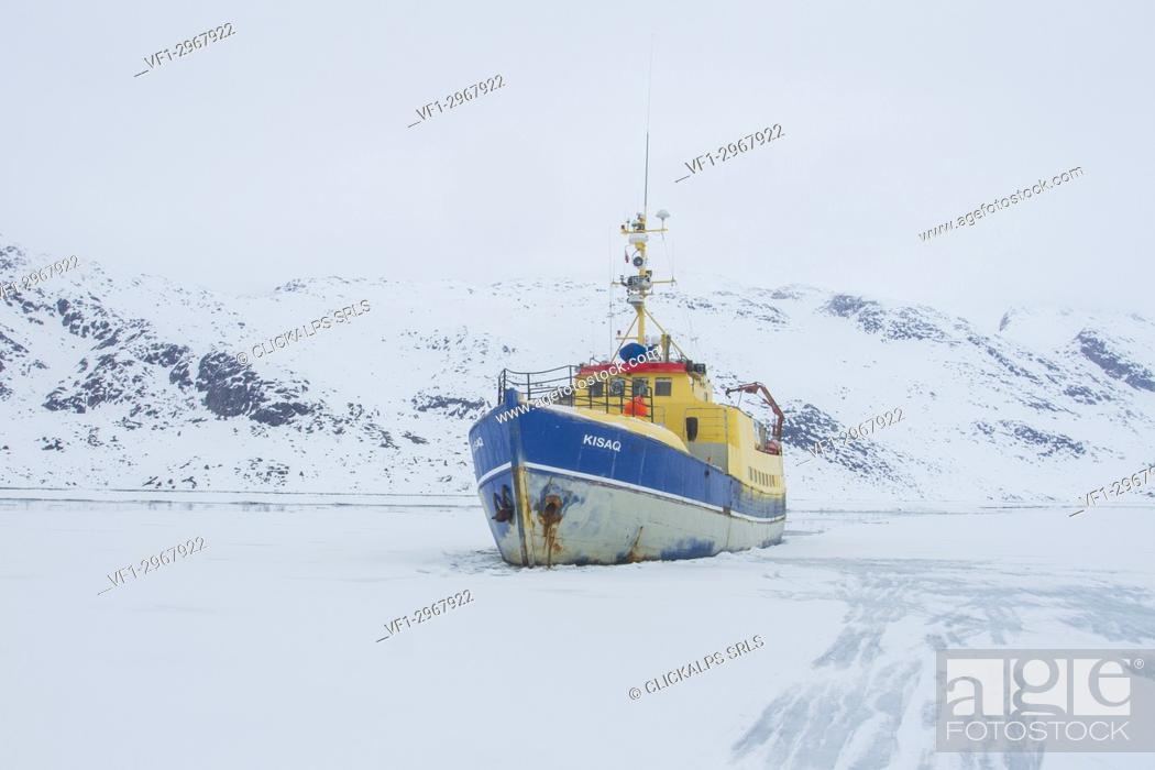 Boat in an iced fjord of West Coast of Greenland - Arctic