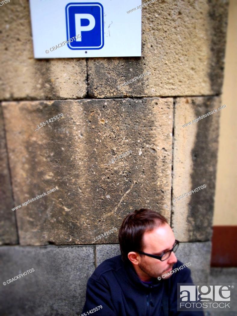 Stock Photo: Man under parking sign.