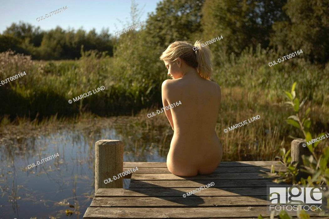 Nude girl in pond