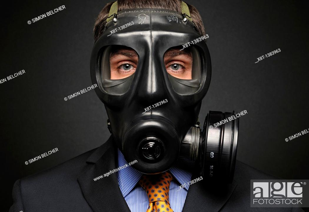 Stock Photo: Businessman Wearing a Gas Mask.