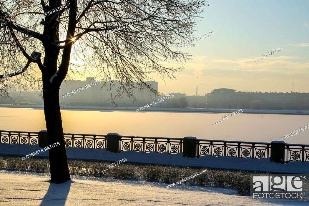 Stock Photo: View of Riga from the 11th November Embankment side. Riga view in winter. Frozen river Daugava at the 11th November Embankment.