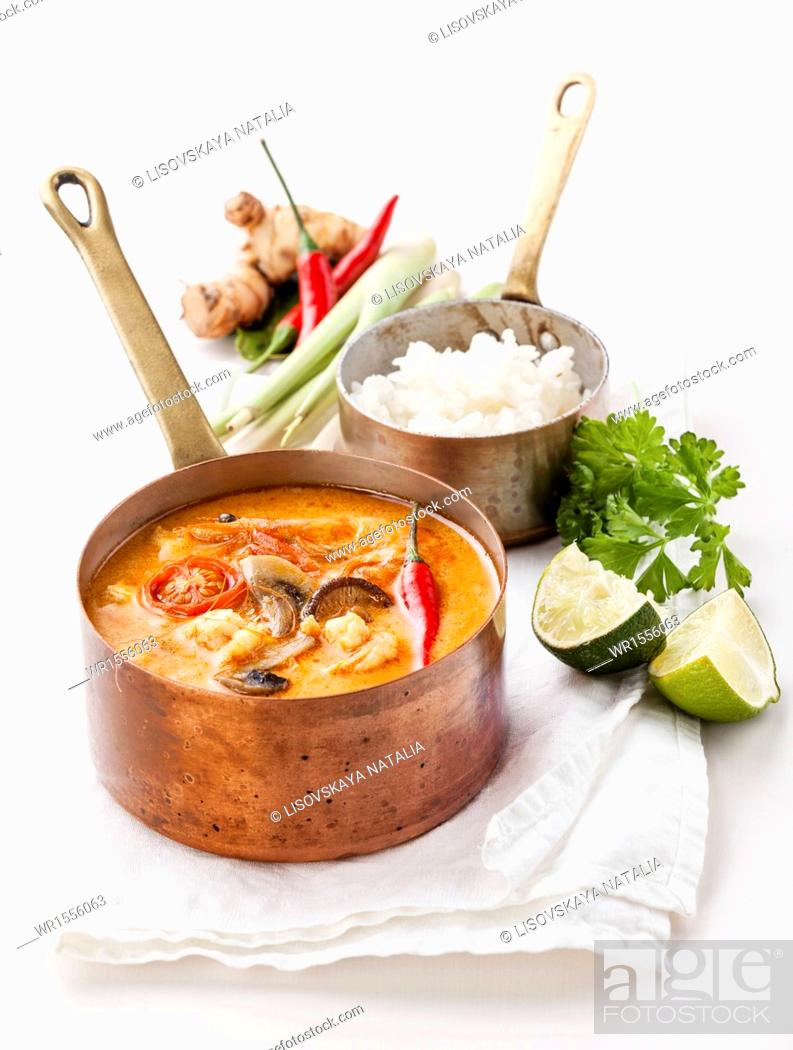 Stock Photo: Spicy Thai soup Tom Yam with Rice, Chili pepper and Seafood on white background.