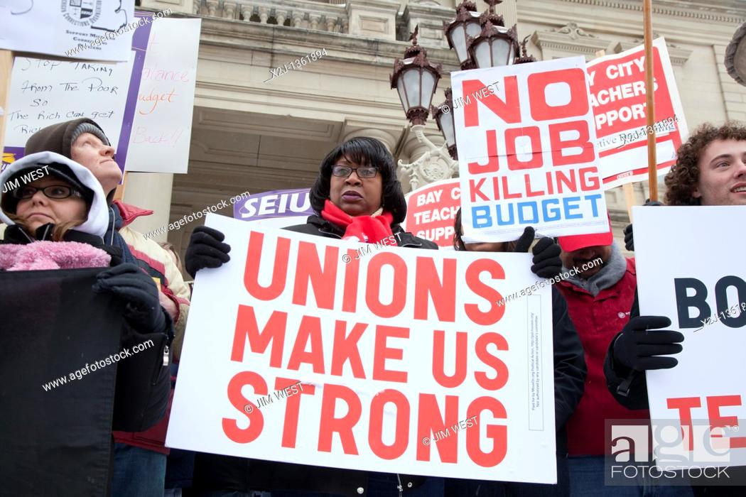 Stock Photo: Lansing, Michigan - Workers rally at the Michigan state capitol in support of public employees in Wisconsin who are fighting to retain the right to collective.