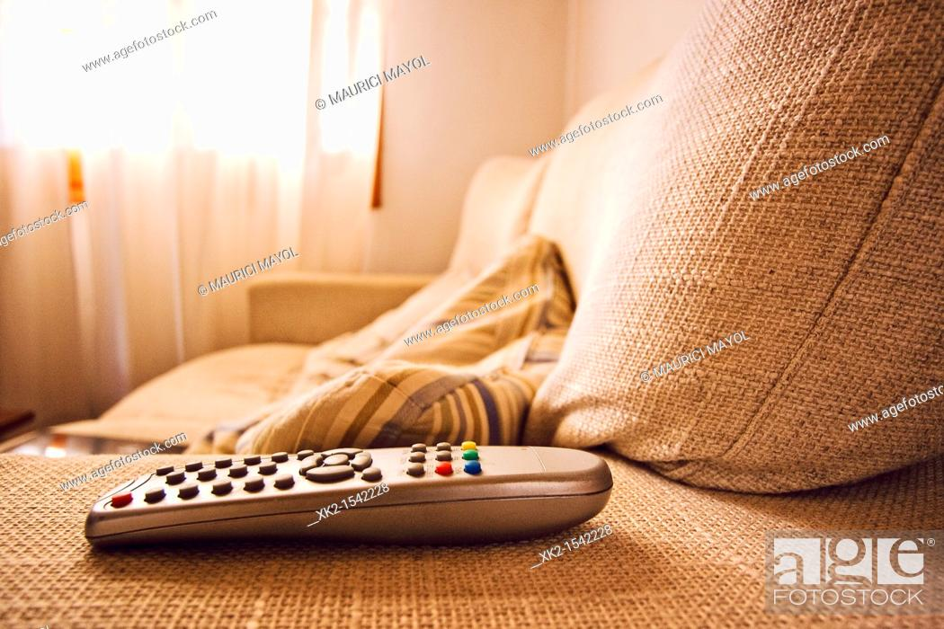 Stock Photo: Detail of the TV remote Control on the sofa.