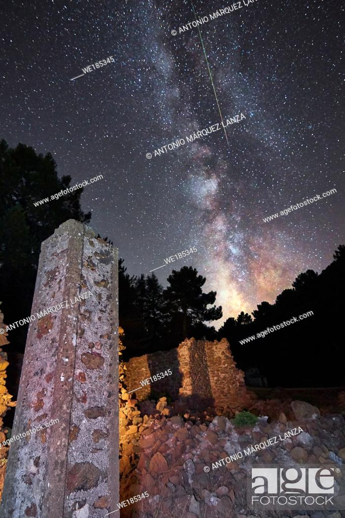 Stock Photo: Milky way in a ruins with a meteorite crossing it.