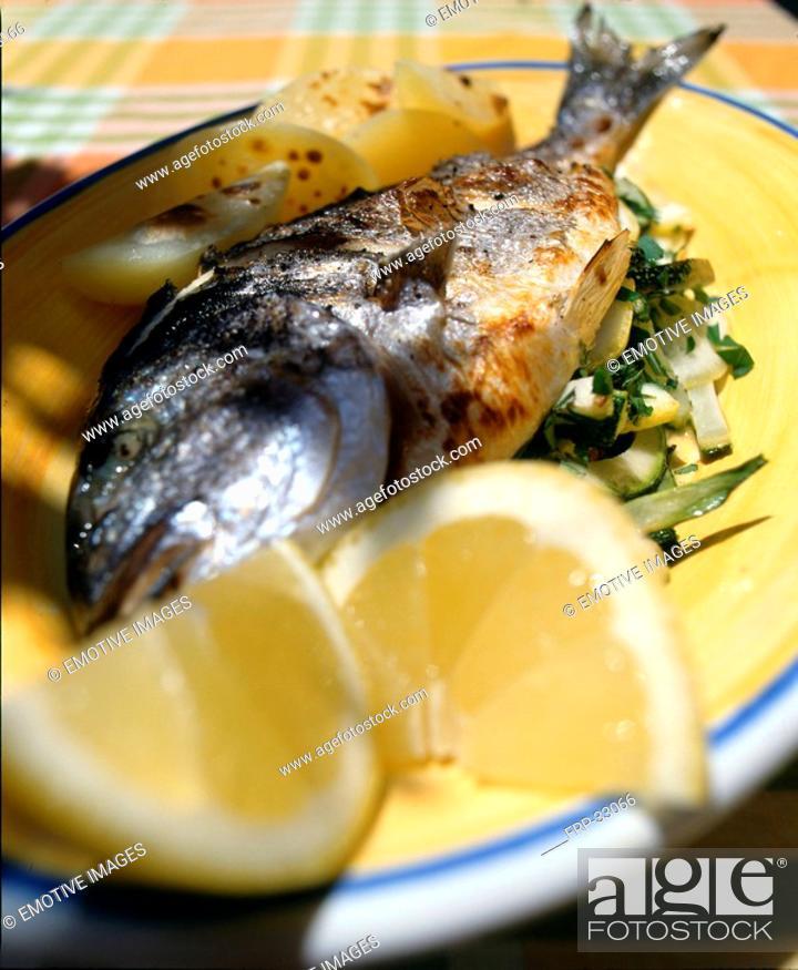 Stock Photo: Fish with lemon sauce.
