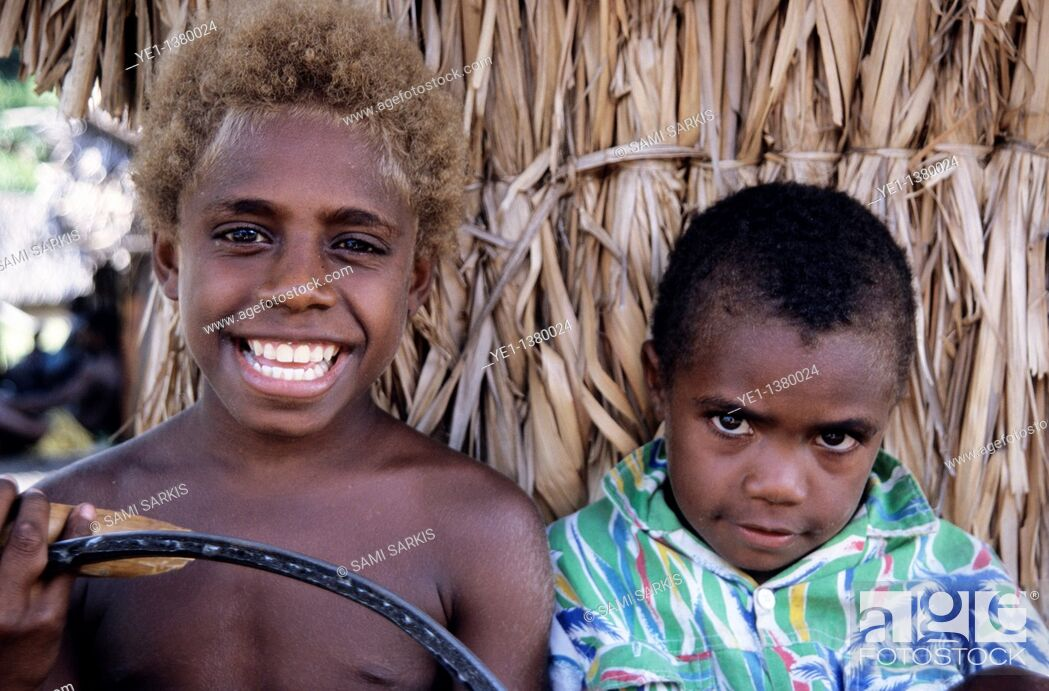 Stock Photo: Portrait of two boys standing side by side, Sulphur Bay Village, Ipekel Ipeukel, Tanna Island, Vanuatu.