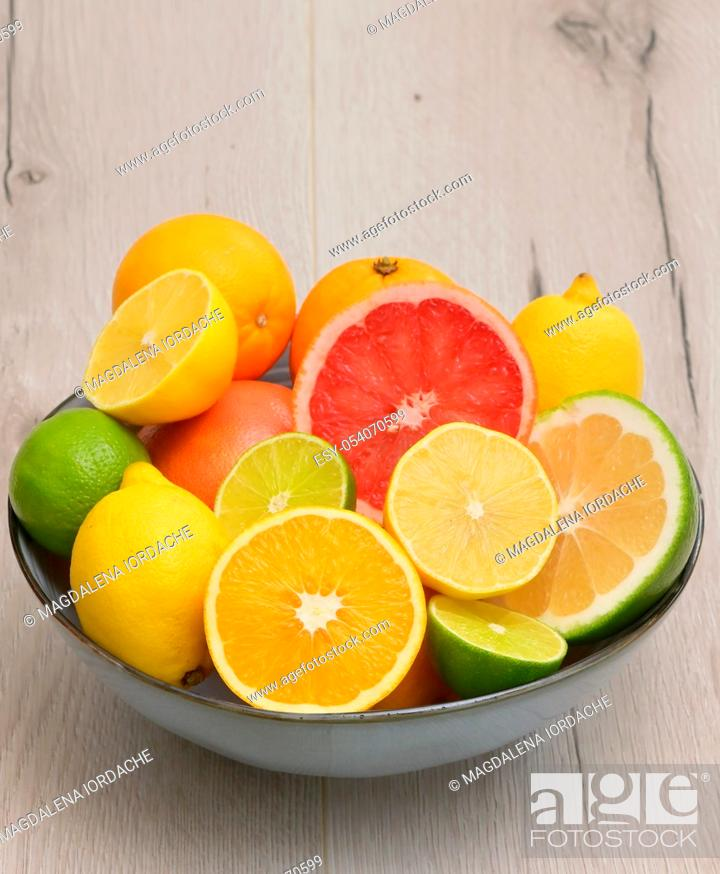 Stock Photo: Colorful Assortment Of Citrus Fruit on Wooden Table.
