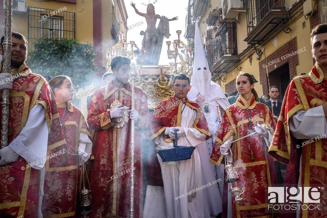Stock Photo: During the Easter week, processions with the image of Christ and the virgin Mary parade around Seville. Monaguillos priest.